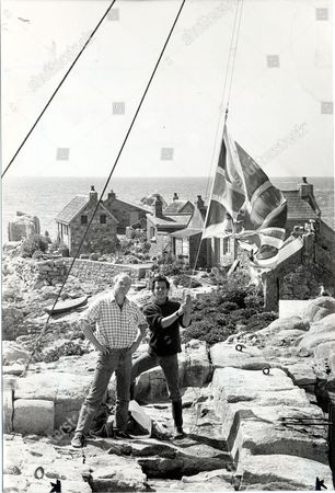 Editorial image of Les Minquiers (the Minkies) Channel Islands Lobster Fishermen Steve Mcguire 18 And Bob Le Marquand 37 Landed On The Outcrop To Find The Union Flag Had Been Replaced By A Strange Tricolour Belonging To The King Of Patagonia And A Plaque Left By A Grou