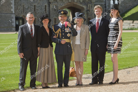 Stock Picture of Air Chief Marshal Sir Simon Bryant, Royal Air Force, Commander-in-Chief Air Command, HQ Air Command, RAF receives a knighthood and is made a Knight Commander with his family (left to right) Richard Meller, Helen Meller Sir Simon Bryant, Helen wife of Simon, their son Benjamin and Alexandra their daughter.