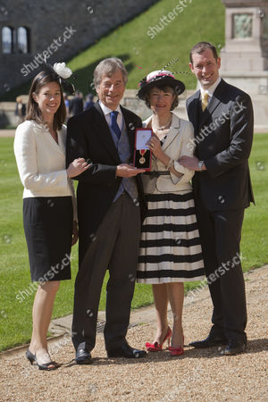 Sir Martin Broughton, Chairman for British Airways, receives a Knighthood for Services to Business with his family (left to right) daughter Gemma Saylor, Jocelyn Martin's wife and their son Michael.