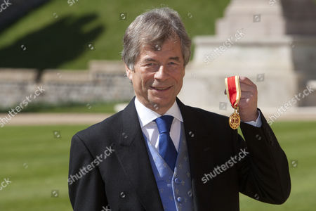 Sir Martin Broughton, Chairman for British Airways outside Windsor Castle after today's Investiture he recived an Knighthood For services For services to Business.