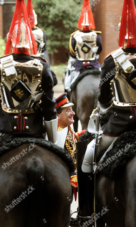 Lieutenant colonel Dan Hughes (centre) inspects troopers from the Blues and Royals, part of the Household Cavalry Mounted Regiment, at the Hyde Park Barracks, Knightsbridge