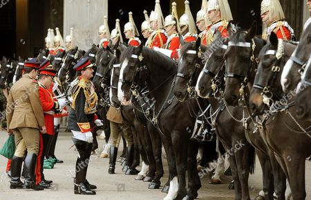 Lieutenant colonel Dan Hughes (standing, holding riding crop) inspects troopers from the Lifeguards, part of the Household Cavalry Mounted Regiment, at the Hyde Park Barracks, Knightsbridge