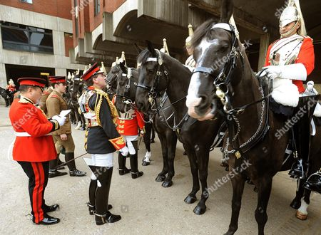 Lieutenant colonel Dan Hughes (2nd left) inspects troopers from the Life guards, part of the Household Cavalry Mounted Regiment, at the Hyde Park Barracks, Knightsbridge