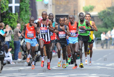 Runners from left: James Kwambai, pace runner, Tsegaye Kebede, Martin Lel and Emmanuel Mutai