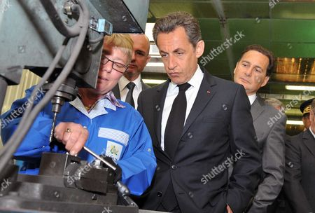 French President Nicolas Sarkozy with Industry minister Eric Besson