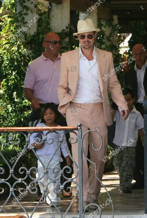 Brad Pitt with his sons Pax Thien Jolie-Pitt and Maddox Jolie-Pitt