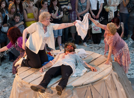 The Procession - tending his wounds in Aberafan Centre: (left) Di Botcher (The Mother), Michael Sheen (The Teacher)