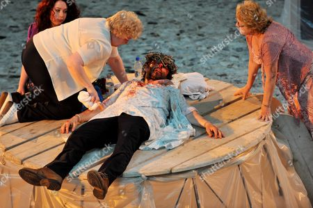 Michael Sheen as The Teacher Jesus is nursed by Di Botcher on a table at Aberafan Shopping Centre