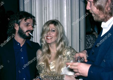 Stock Photo of Ringo Starr, Lynsey de Paul and Harry Nilsson at the 'Tommy' film premiere, London, Britain
