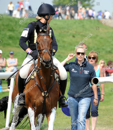 Zara Phillips talks to Elizabeth Power on Kilpatrick River as she warms up for the start of the cross country