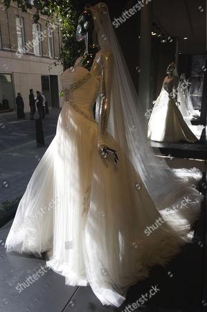Wedding dress in boutique window