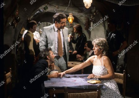 Neil Stacy as Robert Cochran and Joanna Van Gyseghem as Linda Cochran, with Frank Coda as Rodrigo