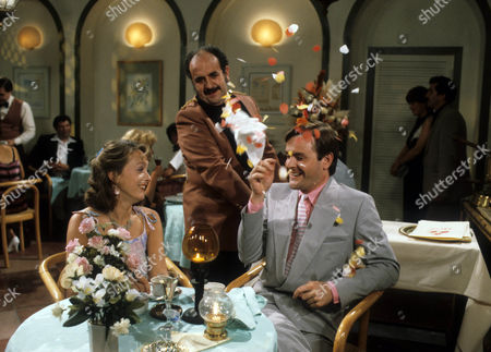 Stock Photo of Diane Bull as Angela and Osmund Bullock as Peter, with Carlos Douglas as Waiter
