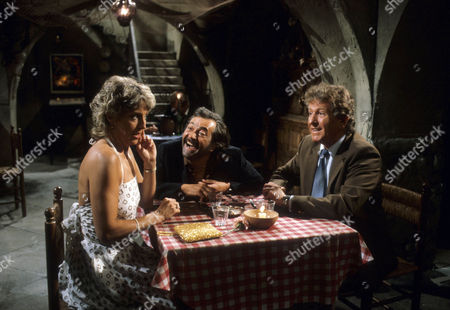 Keith Barron as David Pearce and Joanna Van Gyseghem as Linda Cochran, with Frank Coda as Rodrigo