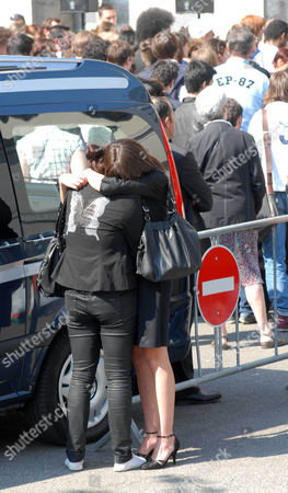 Stock Image of Friends of the children hug during the funerals of the five murdered members of the Dupont de Ligonnes family