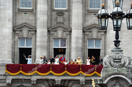 Catherine Middleton and Prince William on the balcony of Buckingham Palace accompanied by members of the British royal family L to R: Carole Middleton, Camilla Duchess of Cornwall, Prince Charles, Camilla's granddaughter Eliza Lopes, Camilla Duchess of Cornwall, Bridesmaids Lady Louise Windsor and Grace Van Custem, Michael Middleton, Catherine Middleton and Prince William, Margarita Armstrong-Jones, pageboys Tom Pettifer and William 'Billy' Lowther-Pinkerton, Queen Elizabeth II, Prince Philip, Pippa Middleton, Prince Harry, James Middleton
