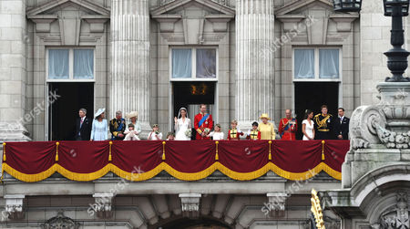 Catherine Middleton and Prince William on the balcony of Buckingham Palace accompanied by members of the British royal family L to R: Michael and Carole Middleton, Prince Charles, Camilla's granddaughter Eliza Lopes, Camilla Duchess of Cornwall, Bridesmaids Lady Louise Windsor and Grace Van Custem, Catherine Middleton and Prince William, Margarita Armstrong-Jones, pageboys Tom Pettifer and William 'Billy' Lowther-Pinkerton, Queen Elizabeth II, Prince Philip, Pippa Middleton, Prince Harry, James Middleton