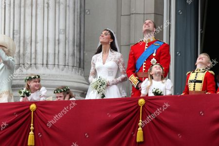 Catherine Middleton and Prince William on the balcony of Buckingham Palace with bridesmaids Lady Louise Windsor, Grace Van Cutsem, Margarita Armstrong-Jones and pageboy Tom Pettifer