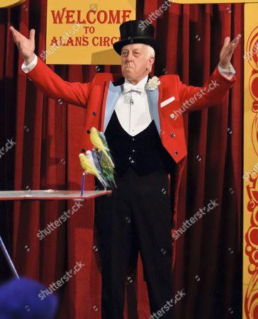 Norman Barrett and his performing Budgies