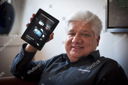 Mike Lazaridis showing off his new PlayBooktablet computer