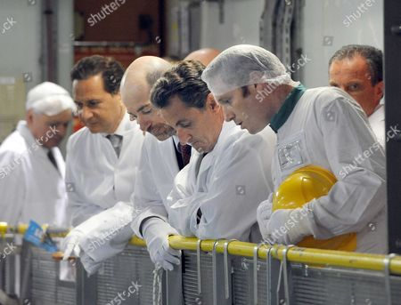 Industry Minister Eric Besson, French President Nicolas Sarkozy and Director of the Gravelines nuclear power station Jean-Michel Quilichini as they visit the nuclear fuel storage site