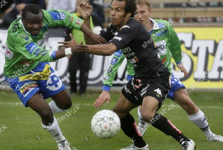 Stock Photo of Chileshe Chibwe (L) of RoPS fights for the ball with Nicholas Otaru of Honka during the Finnish Football League match between FC Honka and Rovaniemen Palloseura (RoPS) in Espoo