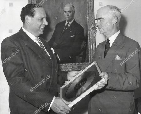 Band Leader Edmundo Ros Recieves A Golden Disc From Sir Edward Lewis Chairman Of Decca Following The Sale Of The Millionth Record Of 'rhythms Of The South