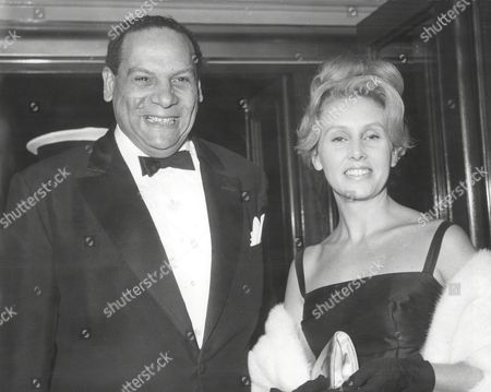 Band Leader Edmundo Ros And His Wife At Film Premiere.
