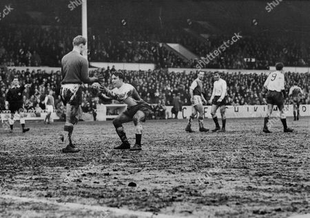 Editorial image of Football: League Match: Tottenham Hotspur V Ipswich Town. Jimmy Greaves Caught Offside For The Umpteenth Time Stoops And Presents The Ball To Ipswich Keeper Jim Thorburn. Spurs 6 Ipswich 3.