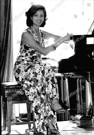 Emily Bolton Actress And Concert Pianist At Piano.