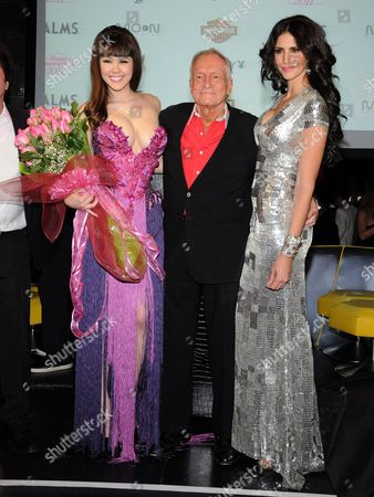 Playboy Playmate of the Year 2011 Claire Sinclair, Hugh Hefner and Playboy Playmate of the Year 2010 Hope Dworaczyk