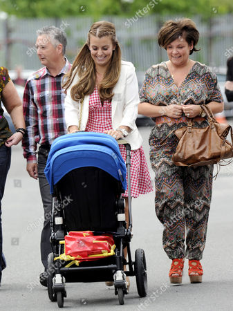 Coleen Rooney and mother Colette McLoughlin with baby Kai Rooney in a pushchair