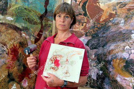 Stock Photo of Artist Kim Atkinson in her studio in North Wales, Britain