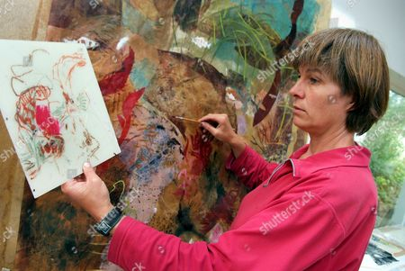 Stock Image of Artist Kim Atkinson in her studio in North Wales, Britain