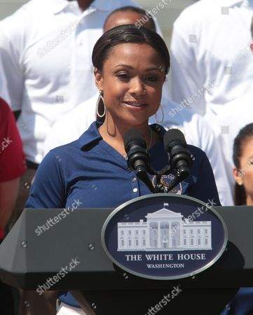 Olympic gymnasts Dominique Dawes attends an event that announced the creation of a program to promote military family wellness at the White House in Washington D.C.