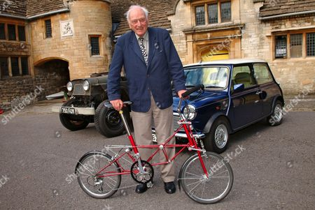 Dr. Dr Alex Moulton with latest version of his bicycle and the Austin Gipsy and Mini that have his suspension fitted