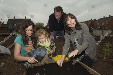 Samantha Cameron Pictured In Her Wellington Boots Visiting The Dobson Lane Allotments Outside Leamington Spa Which Is A Project By The Environment Group Action 21 To Encourage Sustainable Living She Is Pictured Here With Local Conservative Prospective Parliamentary Candidate Chris White And Local Gardeners Alison Smith And Her Son Rufus (2) Planting Onions  29410 See Pa Story Npa Pool Pictures