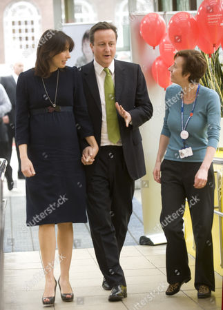 Conservative Party Leader David Cameron Mp And His Wife Samantha Cameron Pictured At The Birmingham Children's Hospital In Advance Of The Third And Final Tv Leaders Debate They Are Pictured Here With The Deputy Chief Medical Officer Fiona Reynolds  29410 Npa Pool Pictures