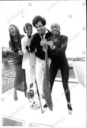Pop Group Boney M With Fish At The Isle Of Man. Marcia Barrett Liz Mitchell Bobby Farrel And Maizie Williams
