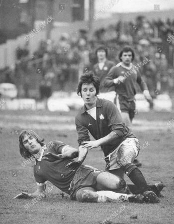 Stock Photo of Football: League Match: Chelsea V Leyton Orient. A Sliding Tackle By Chelsea's Gary Locke Robs Orient's Doug Allder During A Midfield Clash. Chelsea 1 Leyton Orient 1.