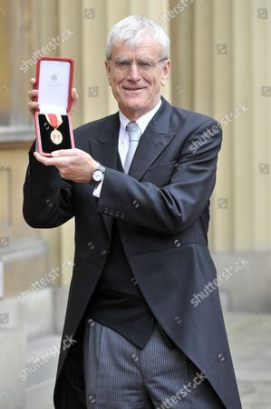 Sir Richard Lambert, Director General of the Confederation of British Industry, receives a knighthood