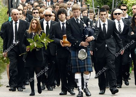 Stock Picture of Javier Ballesteros, next to his sister Carmen, carries the urn containing the ashes of his father Severiano Ballesteros