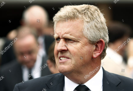 Colin Montgomerie leaves the church after attending the funeral service held for Severiano Ballesteros