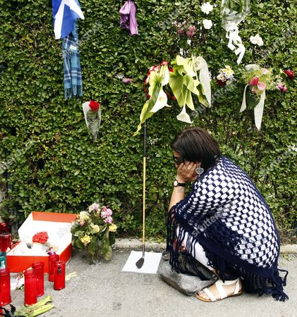 A woman mourns outside Severiano Ballestero's house before the funeral service