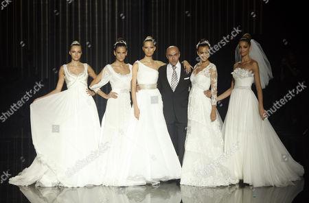 Models including Karolina Kurkova and Irina Shayk with designer Manuel Mota
