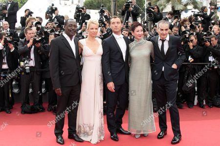 Jury members Mahamat-Saleh Haroun, Linn Ullmann, Jude Law, Nansun Shi and Olivier Assayas