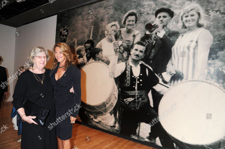 Tracey Emin and her mother, Pamela Cashin in front of a family photograph