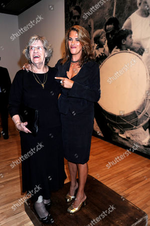 Tracey Emin with her mother, Pamela Cashin in front of a family photograph