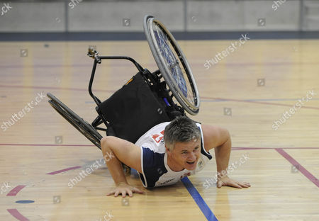 Stock Picture of Des Kelly After Taking On Simon Munn From The Gb Wheelchair Basketball Team