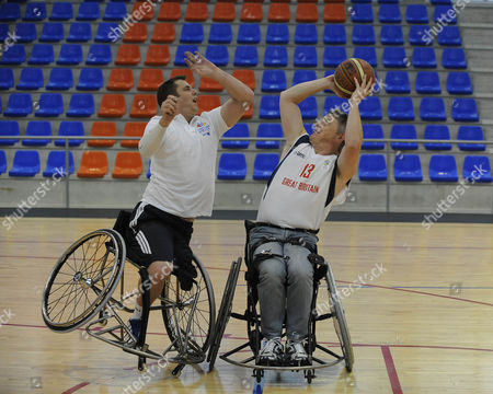 Des Kelly Takes On Simon Munn From The Gb Wheelchair Basketball Team